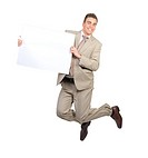Portrait of a cheerful businessman jumping in the air and holding blank card against white background Ready for your product or text