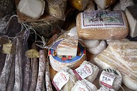 Cheese and sausage displayed for sale in Lucca in the region of Tuscany in Italy