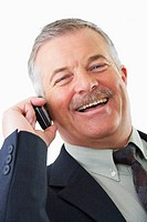 Cheerful senior business man talking on his mobile phone Isolated on a white background