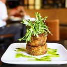 Stacked Crab Cakes with Avocado Puree and Frisee Greens