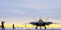 A 90th Aircraft Maintenance Unit crew chief signal an F-22A Raptor laden with concrete bombs to begin its departure for a training mission  For the fi...