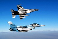 Two F-16 Fighting Falcons feature the new Artic Flanker paint scheme  The aircraft are on the way from Kunsan Air Base, South Korea, Jan  20 to a new ...