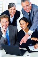 Portrait of a business team _ Business team at a meeting in a light and modern office environment