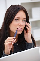 Young modern woman talking on cellphone