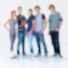 Blurred image of men and women standing against white background
