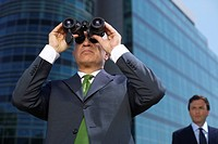 Businessman with spyglass (thumbnail)