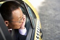 Man looking out of a taxi