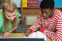 Two students using a computer (thumbnail)