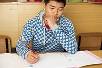 Reflective student doing assignment