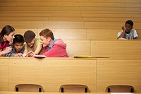 Students in a lecture auditorium, young man sitting in background (thumbnail)