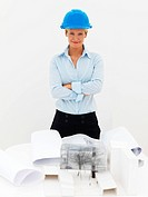 Happy female architect standing against white background