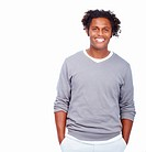 Portrait of a happy young man standing isolated on white background
