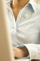 Woman with campaign button at her blouse