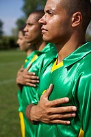 Brazilian soccer players with right hands over hearts