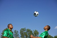 Two Brazilian soccer players heading the ball