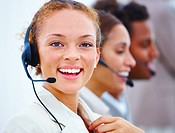 Closeup portrait of a happy young operators with headset