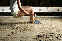 Woman making long jump