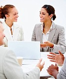 Happy business people in a meeting against white