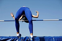 Woman making high jump