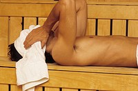 Darkhaired Man putting a Towel on his Face _ Heat _ Sauna _ Wellness
