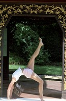 Woman doing Yoga in the Gate of a Temple _ Harmony _ Nature _ Buddhism