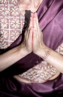 Darkhaired Woman in a Saree has her Hands folded _ Tradition _ Supplication