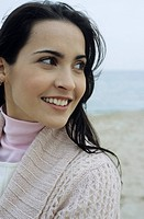 Young brownhaired Woman with Cardigan at the Beach _ Holiday _ Temperature