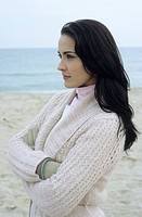 Young brownhaired Woman with Cardigan at the Beach _ Season _ Nature