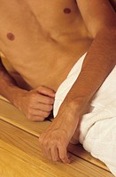 Man with naked Torso and Towel around his Hips _ Section _ Sauna