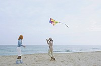 Two female Friends laughing while a Kite flies by _ Friendship _ Fun _ Trip _ Season _ Beach