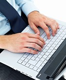 Closeup of male hands typing on a laptop