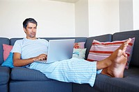 Comfortable mature man working on a laptop at home