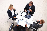 Top view: Portrait of successful business people busy in a meeting