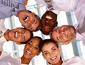 Upward view of successful business people with their heads together
