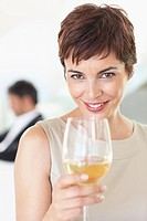 Portrait of beautiful business woman with a glass of drink