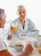 Healthy lifestyle: Old couple having breakfast at the table