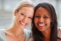 Closeup portrait of an African American woman with her blond friend