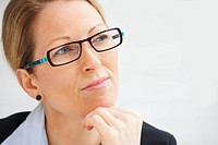 Portrait business woman wearing spectacles looking at copyspace