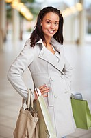Portrait of a charming young woman with shopping bags