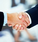 Closeup handshake of two businessmen