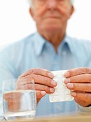 Blurred portrait of an old man having medicines