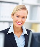 Closeup portrait of a confident young businesswoman in office