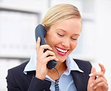 Happy young businesswoman talking on telephone over white background