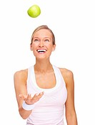 Young happy woman playing with green apple isolated over white background