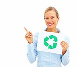Young businesswoman pointing away and holding a recycle symbol over white background