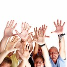 Portrait of men and women with hands raised against white background