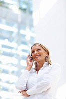 Confident young business woman having a conversation on the mobile