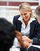 Happy young business woman during a meeting