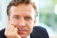 Closeup portrait of a handsome middle aged business man