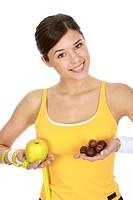 Woman weighing up fruit or chocolates